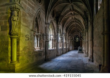 Evora, Portugal - December 1, 2015: Statue of a Saint placed on the cloister of the Evora Cathedral, the largest cathedral in Portugal. Romanesque and Gothic architecture. UNESCO World Heritage Site. - stock photo