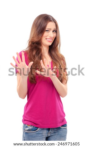 Ew! It's so gross!  Young woman with disgusted expression repulsing something, isolated on the white - stock photo