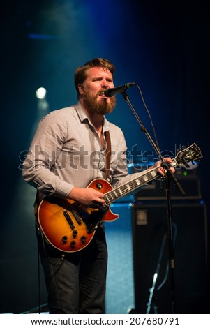 Ewan Currie of The Sheepdogs performs at the Dragon Boat Festival in Ottawa June 20, 2014 - stock photo