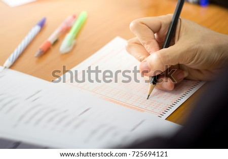 exam concept with answer sheets and pencil