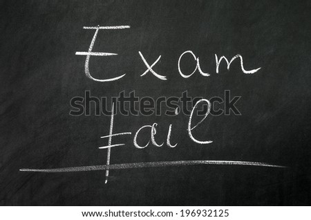 Exam fail writed on blackboard with chalk