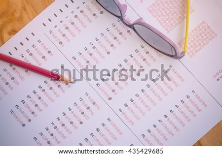 exam paper, answer sheet, test score sheet with pencil : education concept - stock photo
