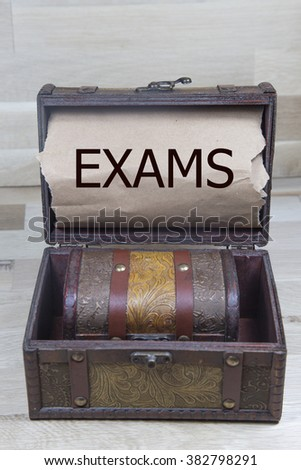 exam sign written with treasure chest. education system and student