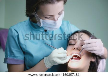 Examination by a dentist - stock photo