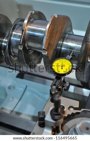Examination of a crankshaft - stock photo