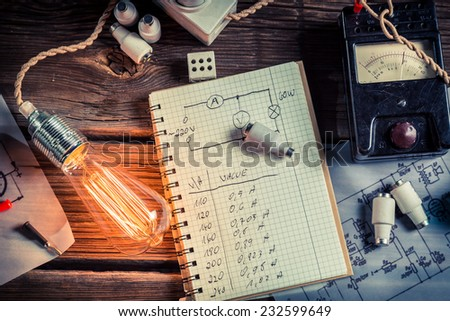 Examination of current flow in the electric light bulb - stock photo