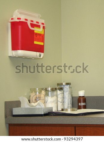 Examination room in a doctor's office or medical clinic complete with supplies. - stock photo
