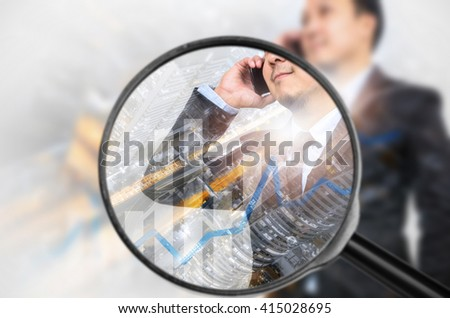 Examining business with magnifying glass, concept examining. - stock photo
