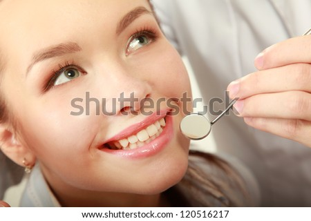 Examining patient's teeth