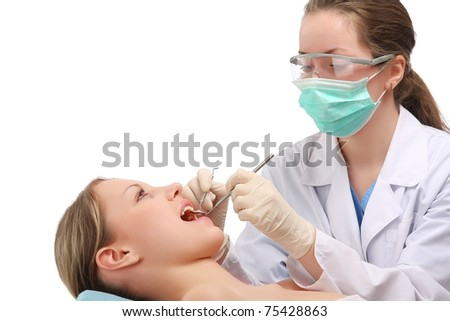 Examining patient's teeth - stock photo