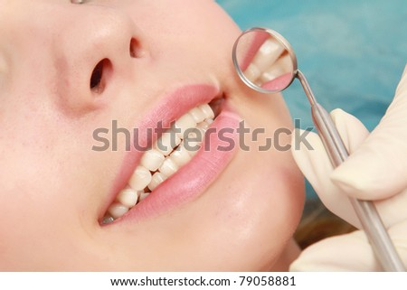 Examining patient's teeth, closeup - stock photo