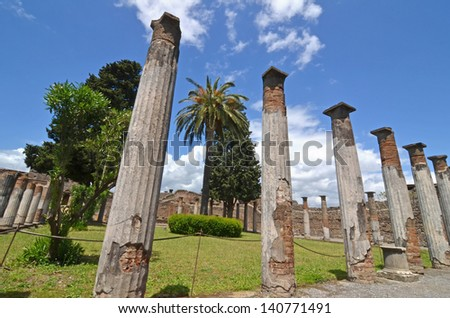 Example of an ancient roman peristilium, a domestic enclosed and columned courtyard. At Pompei, Italy - stock photo