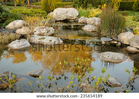 example of landscaping with stream, stones and trees - stock photo