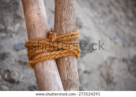 Example of traditional round lashing of two sticks, using hand-made rope of hemp or other natural fibers, in Jodhpur, India. - stock photo