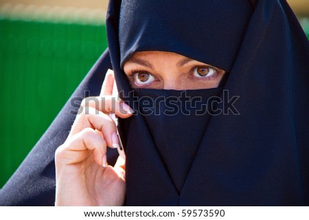 Example picture Islam. Muslim burqa is with obscured. - stock photo