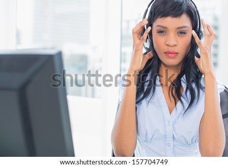 Exasperated operator looking at camera in office - stock photo