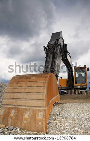 Excavating digger with copy space - stock photo