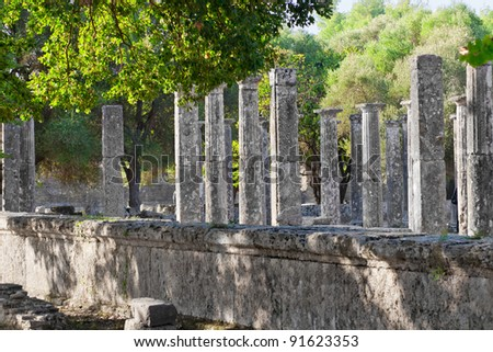 Excavations ancient ruins of the Philippeion at Olympia, Greece. Palaestra at Olympia is part of the gymnasium at the sanctuary.  UNESCO world heritage site. - stock photo