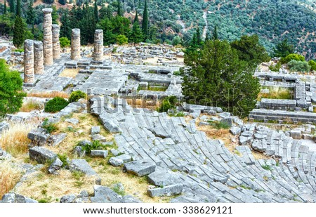 Excavations of the ancient Delphi city along the slope of Mount Parnassus (Greece). The amphitheatre and columns of Temple of Apoll.