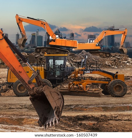 Excavator and grader working at construction site  - stock photo
