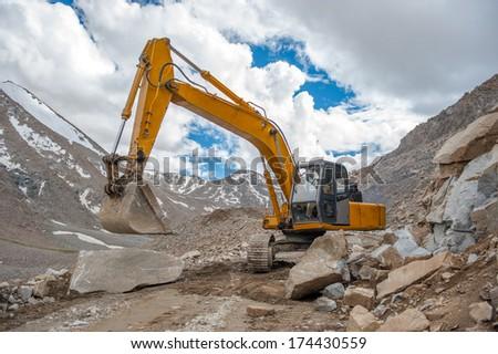 Excavator are work on highest mountain, Leh Ladakh - stock photo