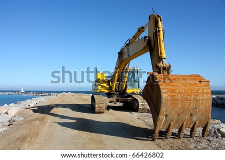 Excavator at a construction site on the coast of Barcelona. - stock photo