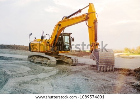 excavator at a street construction site on the countryside