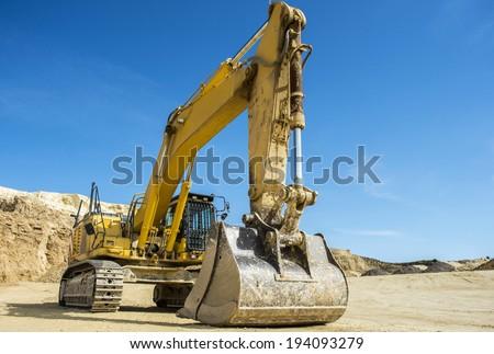 Excavator at Quarry site - stock photo