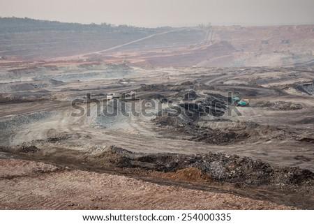 Excavator at the lignite opencast mining - stock photo