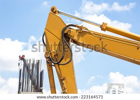 Excavator Boom Arms on a construction site. - stock photo