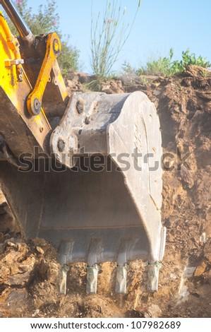 Excavator bucket closeup .Excavation - stock photo