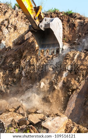 Excavator bucket closeup .Excavation - stock photo