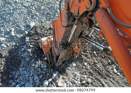 excavator bucket in the career of iron ore - stock photo