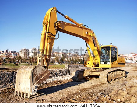 Excavator bulldozer at construction site - stock photo
