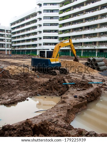 Excavator construction equipment park at worksite. - stock photo