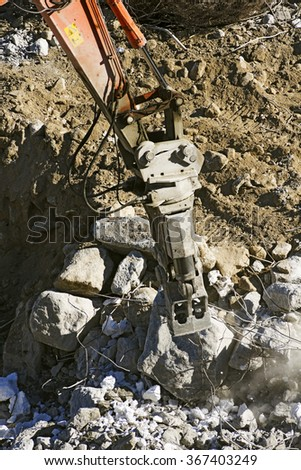 excavator demolition vehicle heavy equipment working in construction site - stock photo