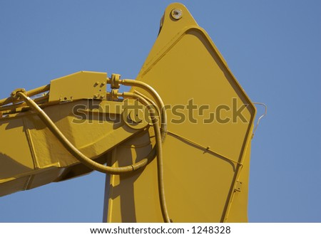 Excavator Detail with Blue Sky Background
