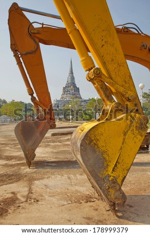 Excavator digging a deep trench Clay shovel loaders - stock photo
