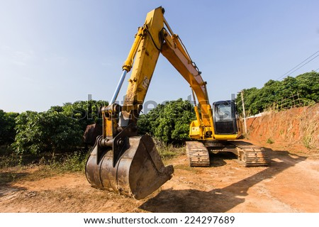excavator digging a trench on the site - stock photo
