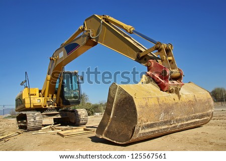 excavator heavy vehicle used in construction industry - stock photo