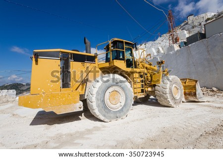 Excavator in a white marble quarry of Carrara, Tuscany, Italy - stock photo