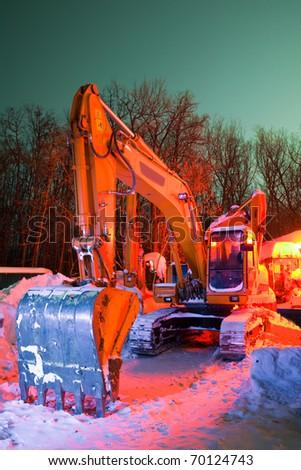 excavator in the snow - stock photo