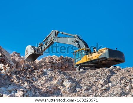 excavator loader machine during earthmoving  - stock photo