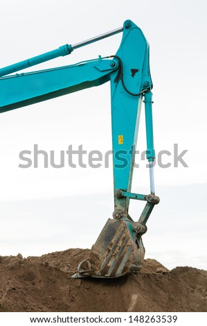 Excavator loader machine during works outdoor at construction site - stock photo