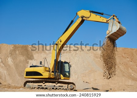 excavator machine at excavation earthmoving work in sand quarry - stock photo