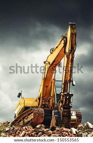 EXcavator machine on construction site during earth moving works - stock photo