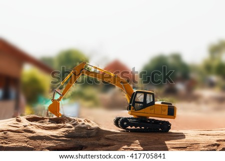 Excavator model on wooden - stock photo