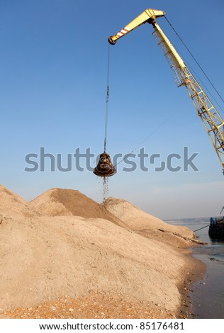 Excavator mounted on a barge on the ground will draw fairway - stock photo