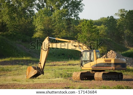 Excavator on a work site in rural America - stock photo