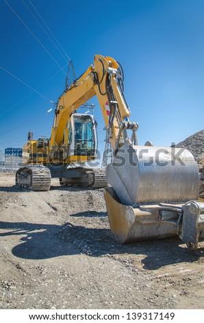 Excavator on construction site - stock photo